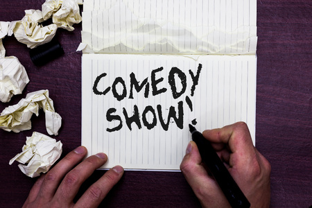 Word writing text Comedy Show. Business concept for Funny program Humorous Amusing medium of Entertainment Man holding marker notebook page crumpled papers several tries mistakes 스톡 콘텐츠