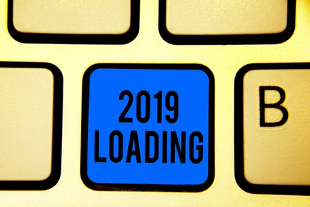 Conceptual hand writing showing 2019 Loading. Business photo text Advertising the upcoming year Forecasting the future event Keyboard blue key Intention computer computing reflection document