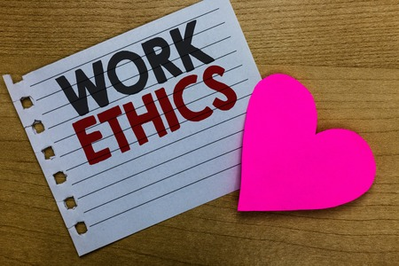 Conceptual hand writing showing Work Ethics. Business photo showcasing A set of values centered on the importance of doing work Notebook paper Romantic ideas heart feelings Wooden table