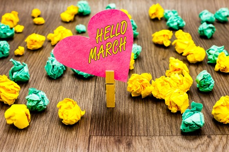 Conceptual hand writing showing Hello March. Business photo text musical composition usually in duple or quadruple with beat Clothespin holding pink paper heart crumpled papers several tries