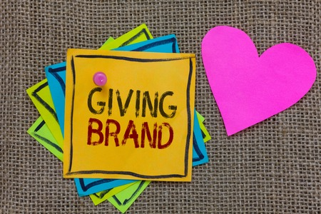 Conceptual hand writing showing Giving Brand. Business photo text The process of giving a Name to a company products or services Paper notes Important reminders Romantic message Jute background