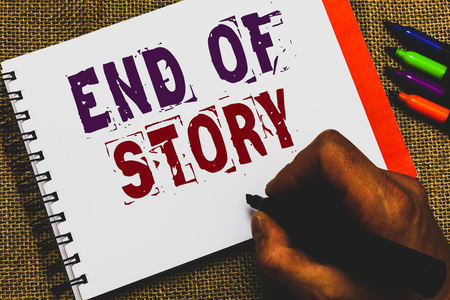 Word writing text End Of Story. Business concept for Emphasize that nothing to add Literature writing Journalism Man hand holding marker notebook paper communicating ideas Jute background