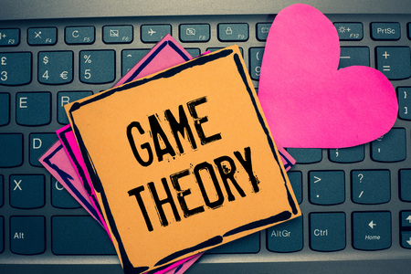 Writing note showing Game Theory. Business photo showcasing branch of mathematics concerned with analysis of strategies Papers Romantic lovely message Heart Keyboard computer Good feelings