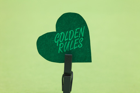 Writing note showing Golden Rules. Business photo showcasing Basic principle that should be followed Important Principle Clothespin holding green paper heart important romantic message ideas