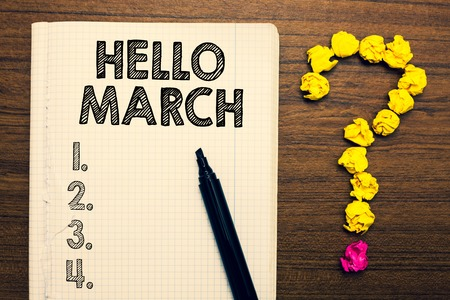 Word writing text Hello March. Business concept for musical composition usually in duple or quadruple with beat Notebook marker crumpled papers forming question mark wooden background