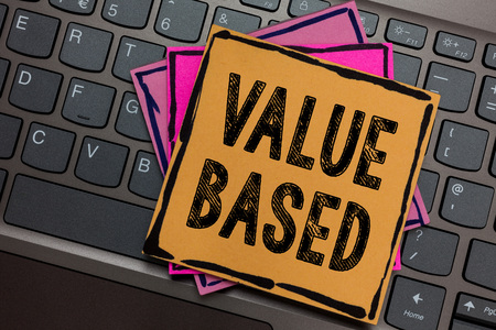 Conceptual hand writing showing Value Based. Business photo showcasing Considering the product worth in satisfying the customer Papers keyboard Inspiration communicate Annotations computer