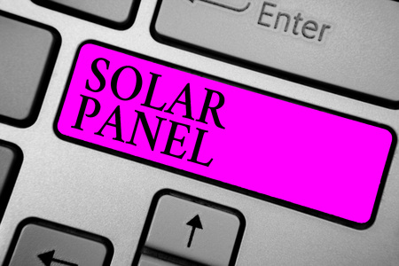 Conceptual hand writing showing Solar Panel. Business photo text designed to absorb suns rays source of energy generating Keyboard purple key computer computing reflection document