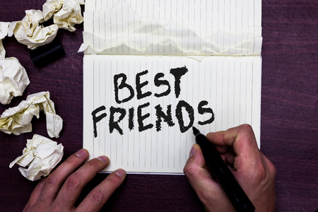 Word writing text Best Friends. Business concept for A person you value above other persons Forever buddies Man holding marker notebook page crumpled papers several tries mistakes