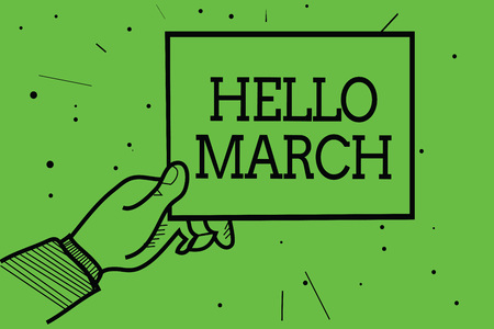 Text sign showing Hello March. Conceptual photo musical composition usually in duple or quadruple with beat Man hand holding paper communicating information dotted green background