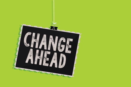 Conceptual hand writing showing Change Ahead. Business photo text Some alterations waiting to happen Perspective Standby Hanging blackboard message communication sign green background Stock Photo