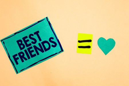 Text sign showing Best Friends. Conceptual photo A person you value above other persons Forever buddies Turquoise piece paper reminder equal sign heart sending romantic feelings