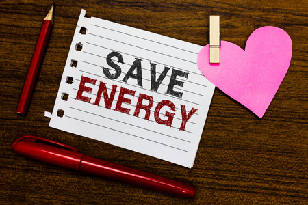 Word writing text Save Energy. Business concept for decreasing the amount of power used achieving a similar outcome Notebook piece paper markers clothespin holding heart wooden background