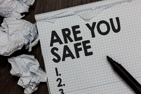 Text sign showing Are You Safe. Conceptual photo Free from danger Not anticipating any Harm Hurt physically Marker over notebook crumpled papers ripped pages several tries mistakes Фото со стока