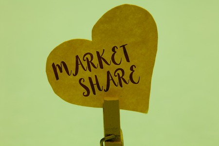 Word writing text Market Share. Business concept for The portion of a market controlled by a particular company Clothespin holding yellow paper heart important romantic message ideas