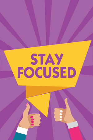 Text sign showing Stay Focused. Conceptual photo Be attentive Concentrate Prioritize the task Avoid distractions Man woman hands thumbs up approval speech bubble origami rays background Stock Photo