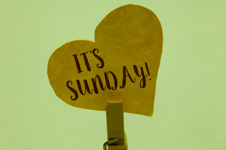 Word writing text It s is Sunday. Business concept for Day of rest and religious worship Part of the weekend Clothespin holding yellow paper heart important romantic message ideas
