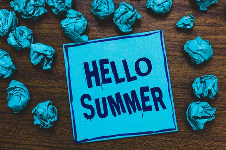 Word writing text Hello Summer. Business concept for Welcoming the warmest season of the year comes after spring Blue paper note reminder crumpled papers several tries wooden background