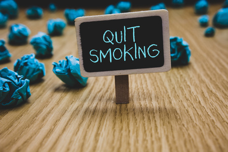 Writing note showing Quit Smoking. Business photo showcasing Discontinuing or stopping the use of tobacco addiction Blackboard crumpled papers several tries not satisfied wooden floor 版權商用圖片
