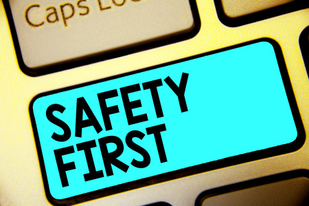 Writing note showing Safety First. Business photo showcasing Avoid any unnecessary risk Live Safely Be Careful Pay attention Keyboard blue key Intention computer computing reflection document