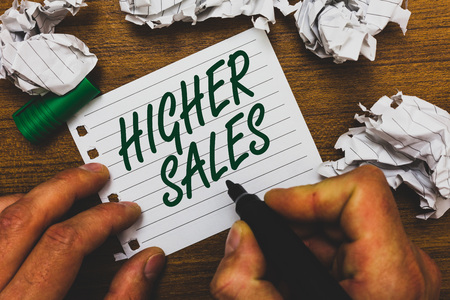 Conceptual hand writing showing Higher Sales. Business photo text The average sold products and services of a company has grown Man holding marker notebook page crumpled papers several tries