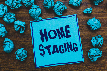 Word writing text Home Staging. Business concept for Act of preparing a private residence for sale in the market Blue paper note reminder crumpled papers several tries wooden background