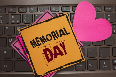 Word writing text Memorial Day. Business concept for To honor and remembering those who died in military service Papers Romantic lovely message Heart Keyboard Type computer Good feelings