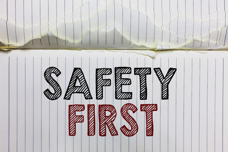 Handwriting text Safety First. Concept meaning Avoid any unnecessary risk Live Safely Be Careful Pay attention Open notebook page crumpled papers ripped pages several tries mistakes