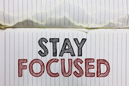 Handwriting text Stay Focused. Concept meaning Be attentive Concentrate Prioritize the task Avoid distractions Open notebook page crumpled papers ripped pages several tries mistakes Stock Photo