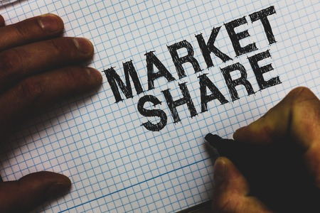 Handwriting text Market Share. Concept meaning The portion of a market controlled by a particular company Man holding marker communicating ideas important messages squared paper