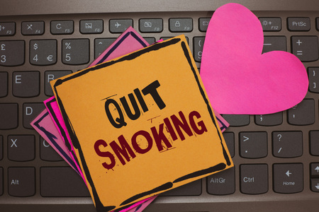 Word writing text Quit Smoking. Business concept for Discontinuing or stopping the use of tobacco addiction Papers Romantic lovely message Heart Keyboard Type computer Good feelings 版權商用圖片
