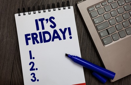 Handwriting text It s is Friday. Concept meaning Last day of the working week Before Saturday or weekends Open notebook white page black marker computer keyboard wooden background Banco de Imagens