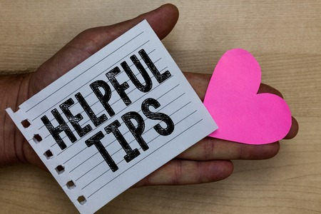 Text sign showing Helpful Tips. Conceptual photo Useful secret Information Advice given to accomplish something Man holding piece notebook paper heart Romantic ideas messages feelings