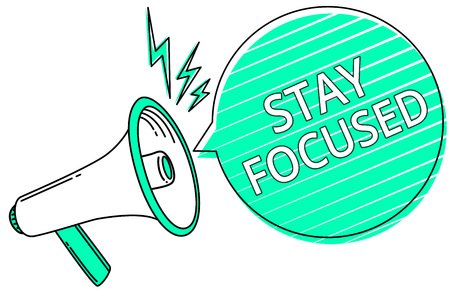 Handwriting text writing Stay Focused. Concept meaning Be attentive Concentrate Prioritize the task Avoid distractions Megaphone loudspeaker green speech bubble stripes important loud message Stock Photo