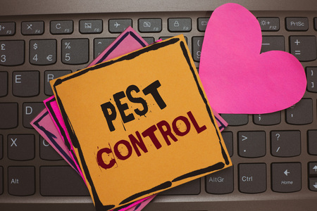 Word writing text Pest Control. Business concept for Killing destructive insects that attacks crops and livestock Papers Romantic lovely message Heart Keyboard Type computer Good feelings