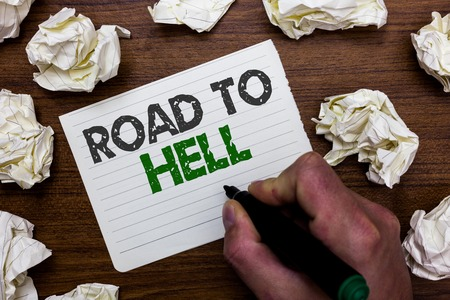 Conceptual hand writing showing Road To Hell. Business photo showcasing Extremely dangerous passageway Dark Risky Unsafe travel Man holding marker notebook page crumpled papers mistakes Reklamní fotografie