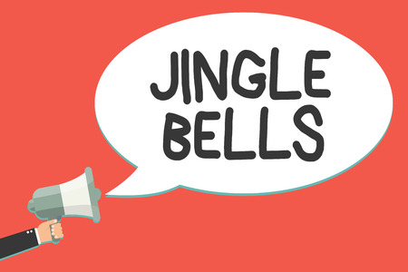 Text sign showing Jingle Bells. Conceptual photo Most famous traditional Christmas song all over the world Man holding megaphone loudspeaker speech bubble message speaking loud Stock Photo
