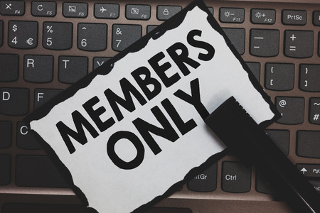 Handwriting text Members Only. Concept meaning Limited to an individual belongs to a group or an organization White paper keyboard Inspiration communicate ideas messages Black markers