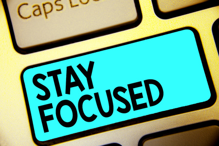 Writing note showing Stay Focused. Business photo showcasing Be attentive Concentrate Prioritize the task Avoid distractions Keyboard blue key Intention computer computing reflection document