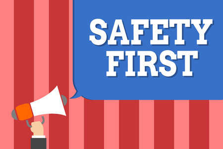 Handwriting text writing Safety First. Concept meaning Avoid any unnecessary risk Live Safely Be Careful Pay attention Man holding megaphone loudspeaker speech bubble message speaking loud Stockfoto