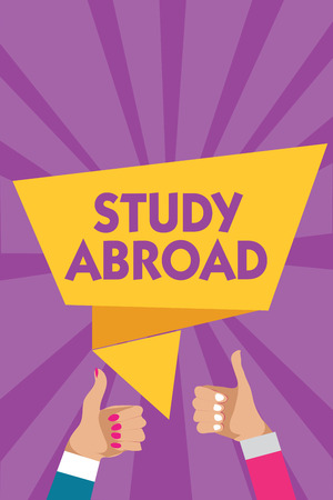 Text sign showing Study Abroad. Conceptual photo Pursuing educational opportunities in a foreign country Man woman hands thumbs up approval speech bubble origami rays background Stock Photo