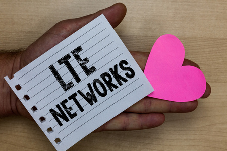 Text sign showing Lte Networks. Conceptual photo Fastest network connection available for wireless communication Man holding piece notebook paper heart Romantic ideas messages feelings Stock Photo