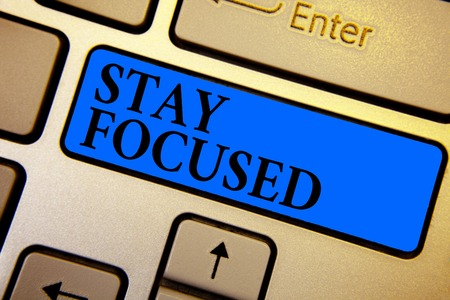 Conceptual hand writing showing Stay Focused. Business photo text Be attentive Concentrate Prioritize the task Avoid distractions Keyboard blue key create computer computing reflection document