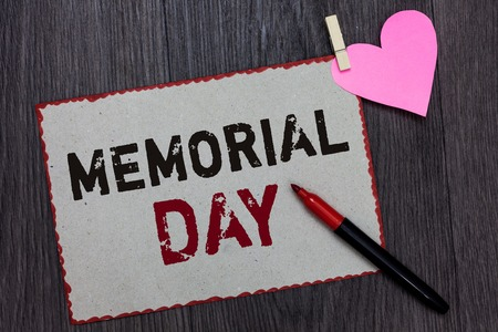 Text sign showing Memorial Day. Conceptual photo To honor and remembering those who died in military service White page red borders marker clothespin holds paper heart wood background