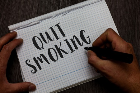 Writing note showing Quit Smoking. Business photo showcasing Discontinuing or stopping the use of tobacco addiction Man hand holding marker communicating ideas reflections squared paper 版權商用圖片
