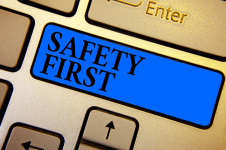 Conceptual hand writing showing Safety First. Business photo text Avoid any unnecessary risk Live Safely Be Careful Pay attention Keyboard blue key create computer computing reflection document