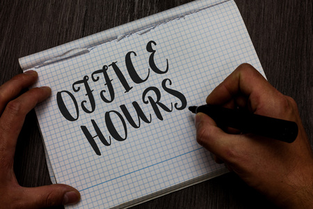 Writing note showing Office Hours. Business photo showcasing The hours which business is normally conducted Working time Man hand holding marker communicating ideas reflections squared paper