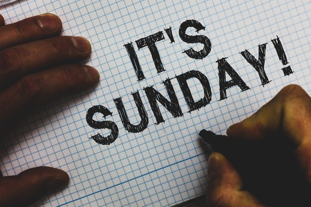 Handwriting text It s is Sunday. Concept meaning Day of rest and religious worship Part of the weekend Man holding marker communicating ideas important messages squared paper Stock Photo