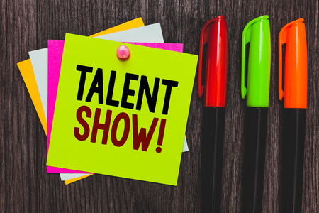 Conceptual hand writing showing Talent Show. Business photo showcasing Competition of entertainers show casting their performances Paper notes Communicate ideas Markers Wooden background