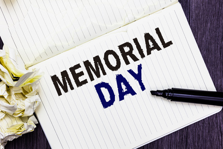 Conceptual hand writing showing Memorial Day. Business photo text To honor and remembering those who died in military service Marker over notebook crumpled papers several tries mistakes