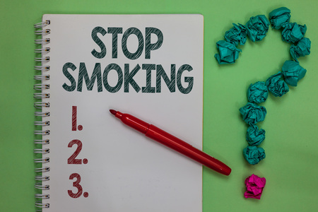 Handwriting text Stop Smoking. Concept meaning Discontinuing or stopping the use of tobacco addiction Notebook marker crumpled papers forming question mark green background Banque d'images